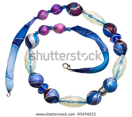 blue textile lady's bead with glass crystals isolated on white - stock photo