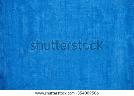 blue texture of shabby paint and plaster cracks - stock photo