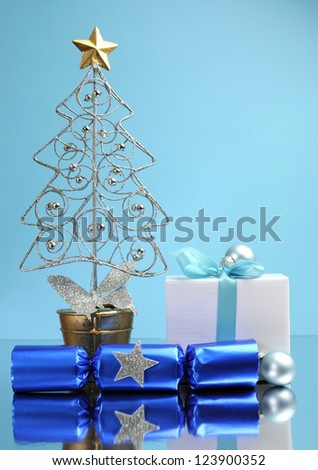 Blue theme Christmas tree, gift and bauble decorations festive holiday still life.