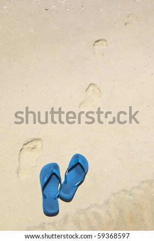 blue thongs at the beach - stock photo