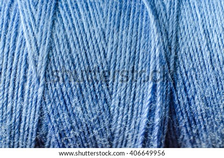 blue thread as a background - stock photo