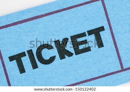 Blue ticket stub macro detail. - stock photo