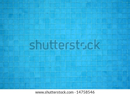 Blue tile mosaic underwater at the bottom of a swimming pool