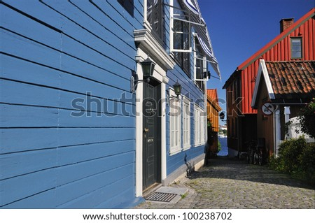 Blue timberhouses in Larvik, Norway, summer time - stock photo