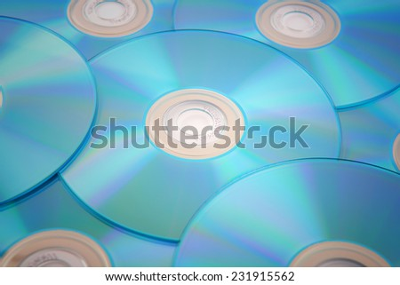 blue tinted close-up of a stack of cd-roms - stock photo
