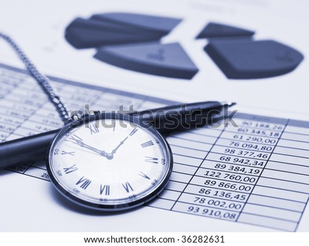 Blue toned chart with clock and pen - stock photo