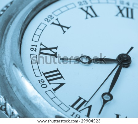 blue toned close-up view of retro poket watch - stock photo