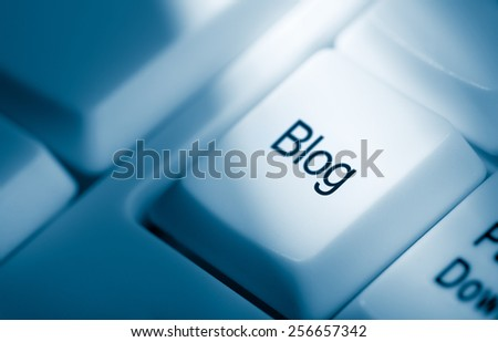Blue toned concept image with blog word on computer keyboard - stock photo