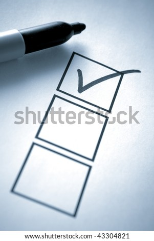 Blue Toned image of Permanent Marker with Check List - stock photo