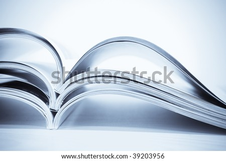 Blue Toned Magazines in Pile - stock photo