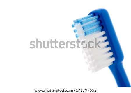 blue toothbrush isolated on white