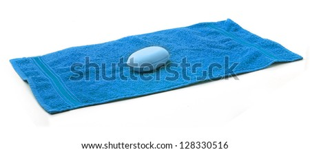 Blue Towel with bar of blue Soap. - stock photo