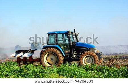 Blue tractor in portuguese field - stock photo