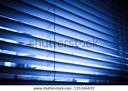 Blue venetian blinds reluxa shader in the office - stock photo