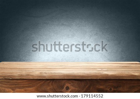 blue wall and desk  - stock photo