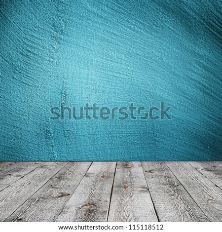 Blue wall and wooden floor interior background - stock photo