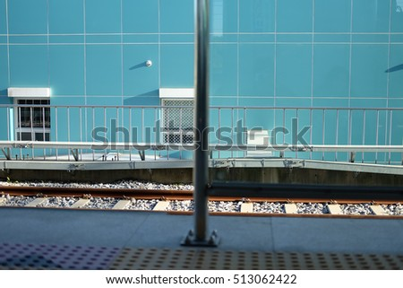 Blue wall with rail