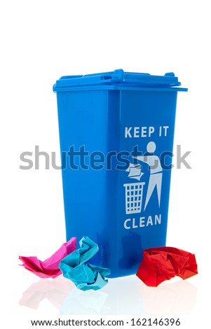 Blue waste basket with paper rubbish isolated over white background - stock photo
