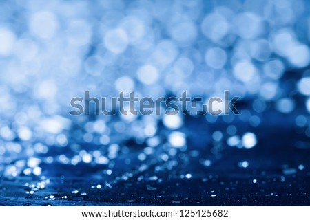 Blue water background with lens flare.