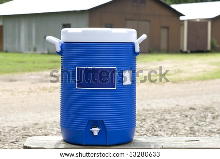 Blue water cooler on bench - stock photo