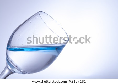 blue water in a wine-glas - stock photo