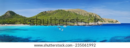Blue water in Majorca. Cala Mondrago - stock photo