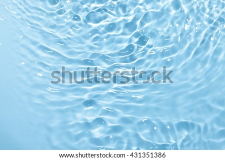 Blue water in sun lights background - stock photo