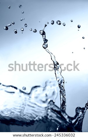 blue Water splash. - stock photo