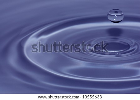 Blue water splash close-up, abstract background - stock photo