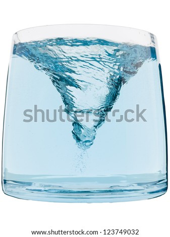 Blue water vortex inside a glass container - stock photo