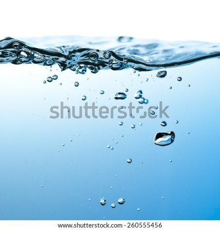 blue water wave and air bubbles