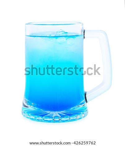 blue water with ice in glass on white background - stock photo