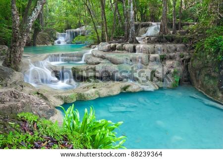 Blue waterfall in Kanjanaburi Thailand (Erawan waterfall) - stock photo