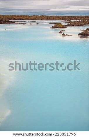 Blue waters of one of the Iceland biggest attranctions -- Blue Lagoon - stock photo
