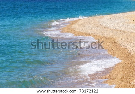 Blue wave on lines of the seashore - stock photo