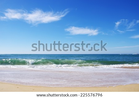 Blue wave on the beach at Portugal - stock photo