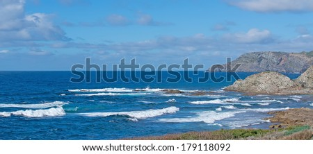 blue wavy sea in Porto Palmas - stock photo