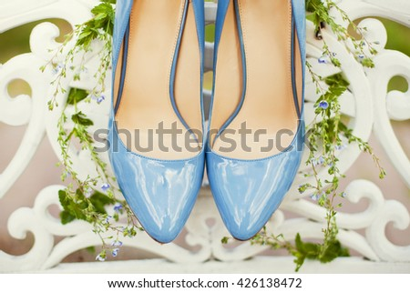 blue wedding shoes and blue flowers - stock photo