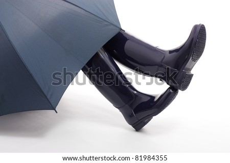 Blue Wellingtons and Umbrella - stock photo