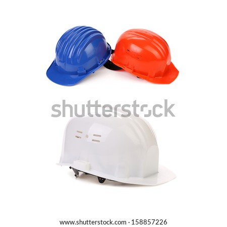 Blue white red hard hats. Isolated on a white background. - stock photo