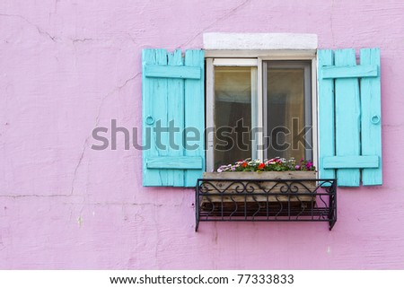 blue window on the pink wall with space - stock photo