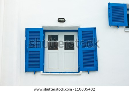 Blue window on white wall, which be the tourist attraction in Thailand - stock photo
