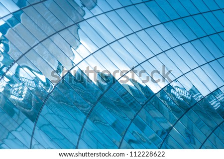 Blue windows of an office with reflection - stock photo