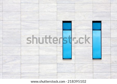 Blue windows of modern office building. city background  - stock photo
