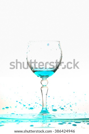 blue wine splash in the glass on white background,blue water drop splash on white background