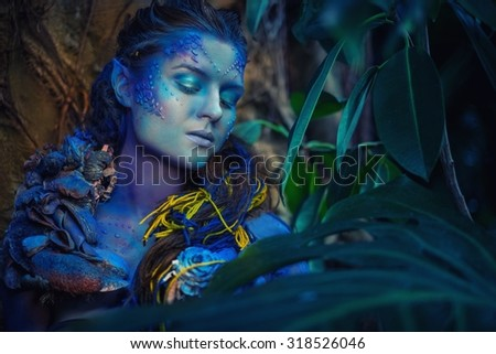 Blue woman creature in a magical forest - stock photo