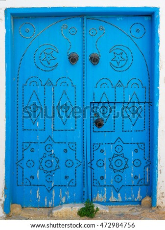 Blue wooden aged door with arch from Sidi Bou Said in Tunisia