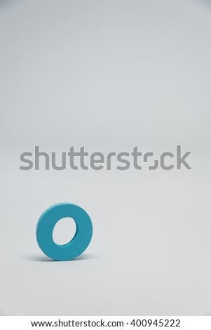 Blue Wooden alphabet O with white background in Vertical view - stock photo
