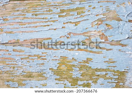 blue wooden background with peeling paint - stock photo