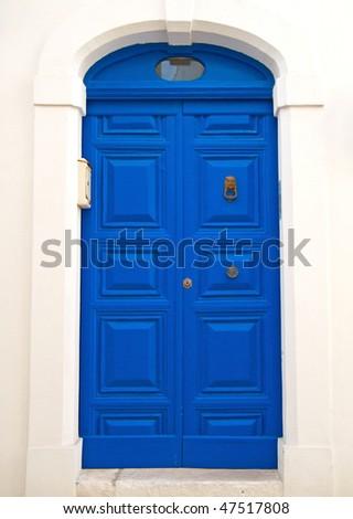 Blue wooden door. - stock photo